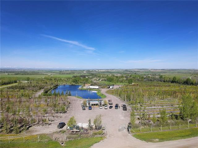 Created by the oxbows of the Highwood River, these unique parcels of land can be purchased as a total tree farm of 165+ acres or separated into a 31+ acre parcel and a 132+ acre parcel with the larger still viable as a tree farm operation. The larger parcel has a home, two large shops, an older barn plus trailer residences for farm workers. This parcel has a large pond supported by an irrigation licence that supplies a drip irrigation system. The land is surrounded by an 8? game fence and gravel base roads traverse the parcel allowing vehicle and equipment access for plant care and harvesting.  The house is fully developed on two levels with attached oversized double garage.