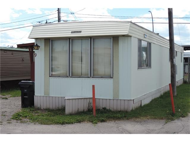 Available for immediate possession. This 2 bedroom + a den needs a little TLC. This unit is located on a corner lot and close to the entrance of the park. The flooring is either tile or laminate no carpeting. The deck is covered which gives you some privacy.