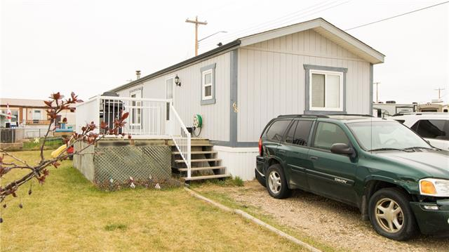 Welcome home!  This amazing mobile home is on a corner lot in the Carstairs Mobile Home Park.  This home has a massive master bedroom with a 3 piece en-suite and walk in closet!  The other end of the home has two bright rooms perfect for the kids!  The large Living room opens onto the bright kitchen and eating area.  Outside there are two decks, both approximately 10'x10'!Perfect for the BBQ!  Call now to see it!