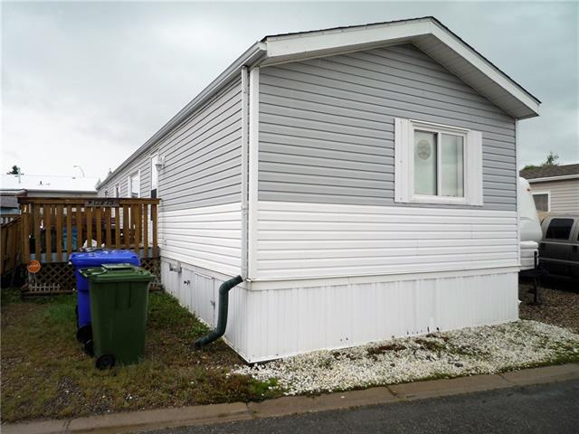 Downsizing?.....Or a Great starter home opportunity in this spacious, pet-friendly 1088 sq. ft. mobile home located on rented land in the Olds Mobile Home Park. There are three bedrooms, a four piece bath and an open concept kitchen, dining and living room area that would be suitable for a growing family.  The master bedroom has a 4 piece ensuite bath.  There is good parking in front with gravel driveway and the yard with wheel chair ramp to the home. New Hot Water Tank in November 2018.  New shingles in 2016 and newer siding as well. Taxes for 2018 are $746.62. The property is very easy to show.