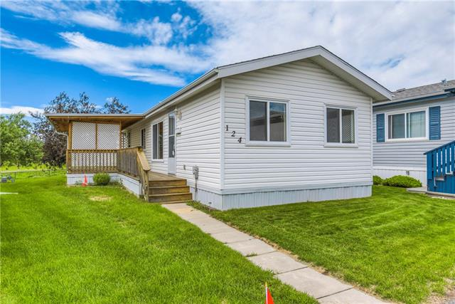 Welcome to Strathmore's 40+ Gated Mobile Home Park. Park features- secured gate access, professional management, R.V storage, special events, landscape maintenance and snow removal, community gardens, club house, fire pit, and more...This home is complete with 3 bedrooms, 1 full bathroom with a open layout, plus a rear garden shed for storage and a covered deck. New paint, flooring, and shingles. All appliances included, Immediate possession available.