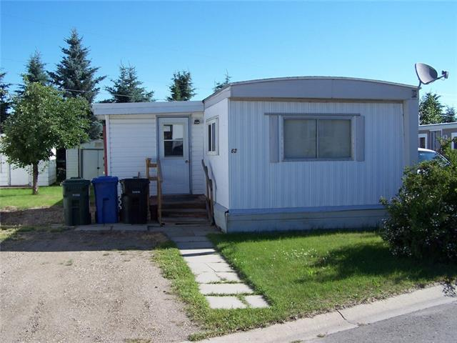 Price Reduced! Affordable option with this single wide mobile home on a rented lot in the Didsbury Mobile Home Park.  Open plan in the main living areas.  3 bedrooms, laundry combined with the bathroom, newer hot water tank, and a porch addition. Located on a good sized lot with 2 (10' X 12') storage sheds. This unit is on the north side of the mobile home park backing onto spruce trees and the farmer's field.  Come have a look!