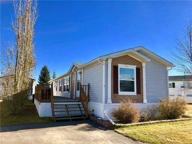 This home located in the family section, at Silver Lynx Mobile Park in Olds, is a must see property for your family! From the moment you step onto the oversized deck, you will know that you are home! Enter the front door to a generous fixed entry. Going to the right, you will have access to bedroom 2 & 3, with a 4pc bath conveniently located between the bedrooms. Take a moment to appreciate the large closets, perfect for the extra storage. As you enter the living/dining/kitchen, you will be thankful for the open concept design, which is perfect for the entertainer in you. Kitchen boasts plenty of cupboards and also contains a built-in cabinet perfect to display your valuables. Main floor laundry -new washer and dryer, and master bedroom are located just past the kitchen area. Master is large, houses 2 closets, and built-in dresser, and features a large 4pc ensuite. RV parking and guest parking are both available. This amazing home, where both snow removal and lawn care are done for you, is priced to sell!