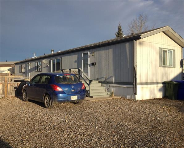1996 mobile home with LARGE fenced yard and two sheds.  Open concept, three bedroom home with two full baths and cathedral ceiling in the living room and kitchen.