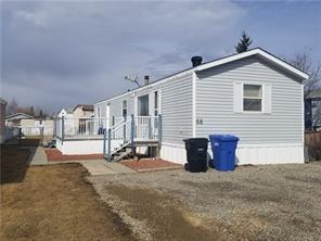 SELLER SAYS THEY ARE MOTIVATED TO SELL THIS AFFORDABLE HOME in Carstairs! An easy commuting town just 40 minutes north of Calgary. This home is in a PRIVATE cul-de-sac with GREEN SPACE beyond. Just under 1000 sq ft, all on 1 level with 3 bedrooms and 1 full bathroom makes this a great home for a family or someone downsizing. Appreciate the large Master Bedroom with a big CLOSET and the 4 piece bathroom, a smaller bedroom/office and laundry close. Another large bedroom is on the opposite end of the home off the SPACIOUS living room. The kitchen has ample cupboards, a dining area and is OPEN CONCEPT & BRIGHT. South facing DECK and a FENCED YARD give you the opportunity to enjoy friends and family. The 12X20 shed in the yard is included and gives a large STORAGE area. Off street PARKING for your vehicles or possibly an RV. Lot rent of $400 per month, + 1 months rent for Damage Deposit. Pets can be allowed with board approval. OWN for cheaper then rent! All utilities and taxes(~$650 for 2018)are owners cost