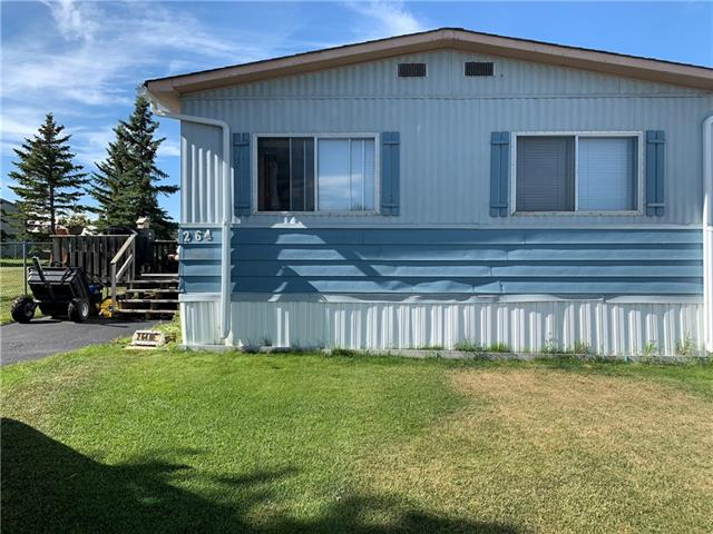 THIS ONE WON'T LAST AT THIS PRICE!. Situated in a cul-de-sac sitting beside green space on a large lot. This home comes with nicely manicured yard, deck, two sheds ample paved parking. Once you walk in you'll notice the spacious Living room, plenty of room for all your guests. Leading to the dining area and kitchen. This home has 3 bedrooms including the Master bedroom with ensuite. Newly painted, furnace was rebuilt just 2 years ago. Roof, eavestrough, and skirt are NEW. Check this one out, you won't be disappointed.