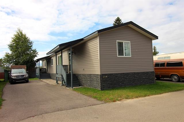 ***  Welcome to the Peace and Tranquility of Calgary Village.  This 2014 3 bedroom 2 Bathroom Mobile Home is in Immaculate Move-in condition.  Porches added to Front and Rear Entrances.  Overlooking green space across from Park and Baseball Diamond.  Clubhouse is under construction and will house a Gym, Games room, Community Kitchen for all Residents to enjoy.  Watch the Elliston Park Fireworks from the comfort and convenience of your own Backyard.  Park Fee includes Shaw Cable TV, Jabba Internet, Sewer, Water,  Garbage pick up and Snow Removal on Roads. Pets welcome with Park Approval.  Easy Access to Shops, Cinemas, Schools, Parks, Stoney Trail Ring Road and most other Amenities.