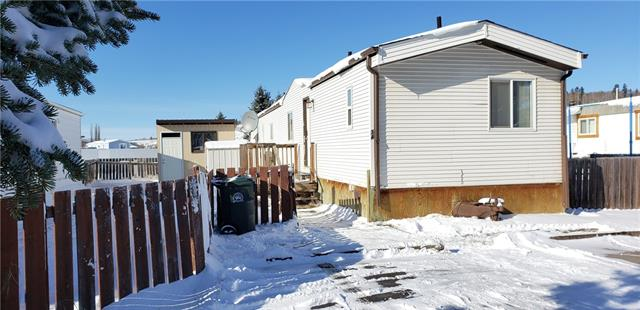 AFFORDABLE HOME OWNERSHIP IN SUNDRE! Whether this will be your VERY FIRST HOME or you are LOOKING TO DOWNSIZE, this mobile on a rented lot is MOVE-IN READY! Renovated inside and out. New siding, roof and WINDOWS in 2012. The inside was completely gutted and redone! Includes a 4-piece Ensuite and WALK-IN CLOSET for the Master Bedroom. At the other end of the home, your kids or guests will be able to enjoy their space and their own 4-piece bathroom. Furnishings in home are negotiable. Walking trails on snake hill are located right behind this park. The rodeo grounds, schools, arena, swimming pool and public library are right around the corner for your enjoyment. This property is a must see. Pictures never do a property justice. HOME IS WHERE YOUR STORY BEGINS!