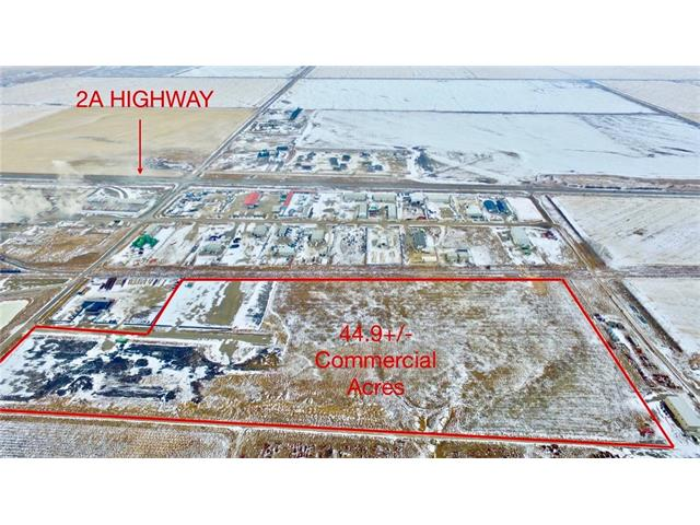 44.9+/- acres, 30 minutes south of Calgary on Highway 2A, 5 minutes north of High River. Municipal water and sewer. On Rail line. Will sell all 44.9 +/- acres or in 5 acre lots starting @ $250.000 per acre + Off site Levies Cost. Overland drainage ponds done for all of the property. Will build to suit.
