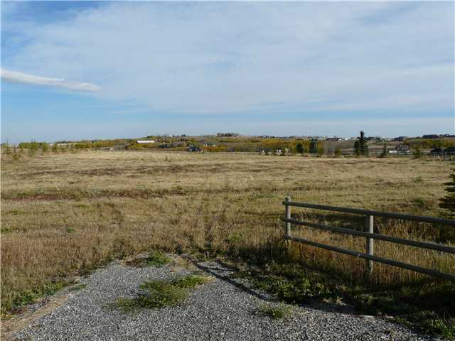Fantastic location, 0nly minutes to Calgary or Okotoks. Walking distance to ST Francis of Assisi  and  Heritage Height Schools. New community Arena and accsess to three Golf Courses. Only 17KM to Shaunessy Shopping complex, Public Transportation & C-Train station. private location backing onto the Environmental Reserve. This lot is Rail fenced, has utilities and a drilled well .Don't Wait! get started on the plans for your new Dream Home in this Country  Estate Subdivision. Architectural Controls in place . No building  commitment !