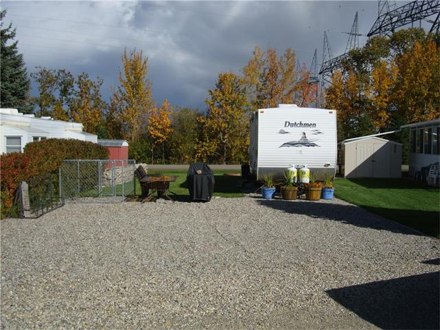 Excellent Price on this 2 bedroom, 2005 Dutchmen trailer that sleeps up to 10 people.  Comes with fridge, stove, microwave, queen bed, hide-a-bed, 4 bunks and a retractable awning.  The spacious yard has an outdoor table & chairs, shed, firepit and dog enclosure with a sunshade.  Located on a very large, pie-shaped lot accross from the Fountain.  Plenty of parking for all the toys.