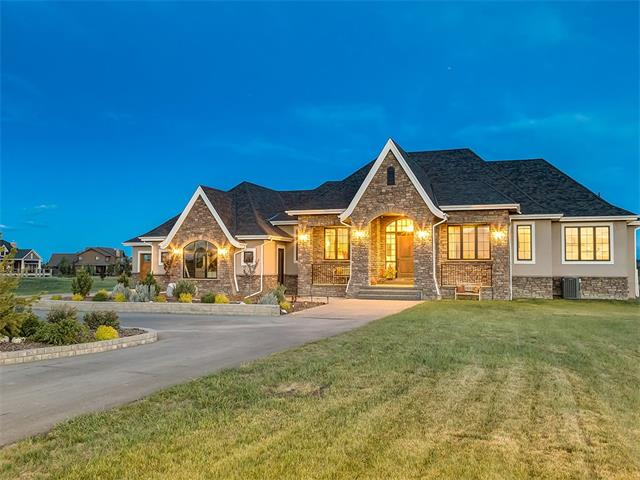 Over 5400 sq ft of BEAUTIFUL CUSTOM development in this SPECTACULAR WALK-UP bungalow located on 2.02 ACRES in PRESTIGIOUS WINDHORSE MANOR! BREATHTAKING MOUNTAIN VIEWS + HIGH END features inc HAND SCRAPED HARDWOOD FLOORS, 12.5 ft + FLAT ceilings, CENTRAL A/C, ON-DEMAND HOT WATER, IN-FLOOR HEAT, FULL AUDIO + SECURITY SYSTEM BUILT-IN, O/S QUAD GARAGE + more! Sweeping driveway welcomes you HOME w/LARGE porch + GORGEOUS TILED foyer, front office + OPEN CONCEPT living area w/GAS F/P + doors to the BIG DECK! GOURMET kitchen has a GAS STOVE, WALL OVEN, BREAD WARMER, POT FILLER, GRANITE COUNTERS + HANDY BUTLERS KITCHEN leading to the FORMAL dining rm- PERFECT for ENTERTAINING! LUXURIOUS Master Suite has DOUBLE SIDED F/P, HUGE WALK-IN closet + EN-SUITE w/SOAKER TUB + DUAL VANITY! 2nd bedroom also has EN-SUITE + WALK-IN closet! Powder rm, laundry + mud rm complete the main level! Downstairs are 2 more LARGE bedrooms both w/EN-SUITES, MEDIA rm, FITNESS rm, WET BAR + REC RM w/doors to the STAMPED PATIO! A MUST VIEW!!!
