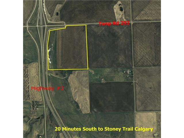 Queen Elizabeth II highway frontage, 137.67 acres. Great development site. Easy access with overpass on North boundary. 20 minutes North of Calgary