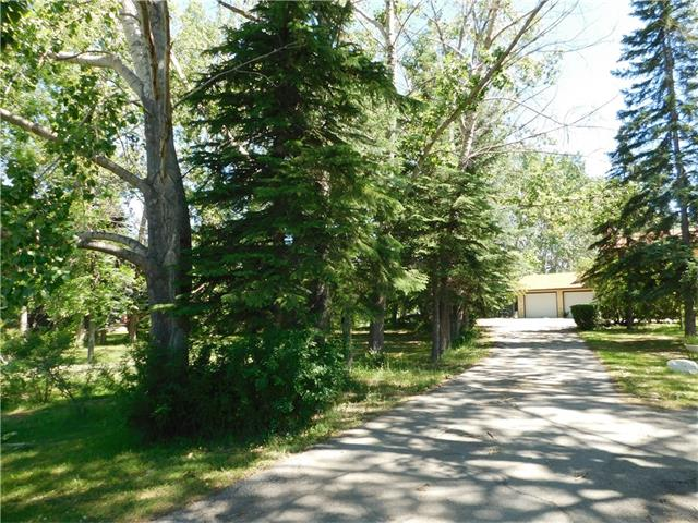 """HERE IS THE BEST OPPORTUNITY TO LIVE SO CLOSE TO THE CITY,GOLF COURSE, THIS 2 ACRES PARCEL OFFERS , PARK LIKE SETTING ,LOTS OF TREES,FLAT LAND ,WALK TO HEATHER GOLF,FULLY FENCED 2 ACRES, IT OFFER LARGE DOUBLE GARAGE, SHED,AND EXTRA COVERD PARKING, GREAT LAYOUT OF THIS HOME,2 LIVING ROOMS,WITH FIRE PLACES,VAULTED CEILINGS,KITCHEN OVER LOOKING TO THE """"PARK LIKE BACK YARD"""" 4 BEDROOMS UP,WITH A 4 PCE BATH,AND 3 PCE ENSUITE,YOU WILL LOVE THE LARGE FRONT ENTRY. PLEASE CALL FOR YOUR SHOWING.....  MAKE THIS HOME YOUR HOME ..."""