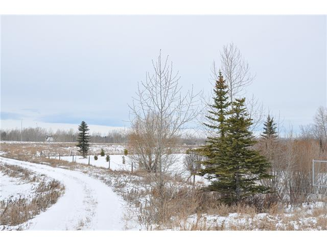 Great opportunity to build your new home, close to two new schools Heritage Heights and a Catholic School 10 minutes from Calgary or Okotoks. There are two drilled wells on the property. Reports are available. Located on top of the hill with views of the city.  Beautiful location and access to Calgary or Okotoks.