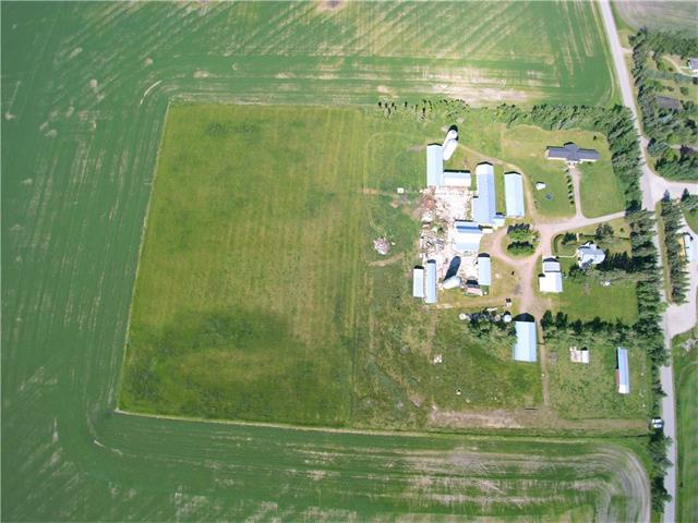 Amazing opportunity!Unlimited possibilities!This unique 20 acre building site was formerly a dairy farm. Multiple buildings that can be repurposed for your personal enjoyment or for income potential.Let your imagination go wild.This wide-open space features two houses.One newer,luxurious home and an older home can be used for family or rented for additional revenue.The newer 3,170 sq ft bungalow is stunning and offers a very functional floor plan with many high quality features.The kitchen is absolutely striking, spacious with plenty of cabinet and counter space, a huge island and is open to the dining and living room areas. Natural light and country views at every turn.Down the hallway are three bedrooms, a bathroom and laundry area.The master retreat has its own beautifully finished 4 pce ensuite and walk-in closet. The family room is at the other end of the home leaving the bedroom area quiet and peaceful.There is easy access to the QE2 highway. Call for your personal tour of this fantastic property.