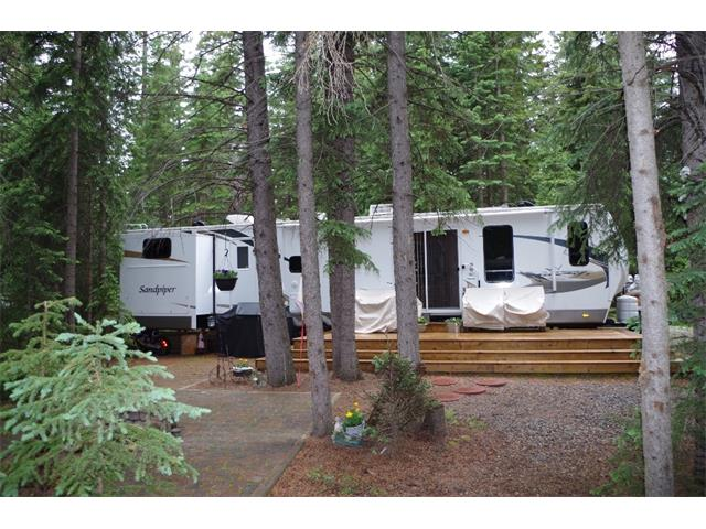 Your home away from home. Located in Tall Timber RV Park in the town of Sundre, this secure gated park has everything you could ask for. The park has a swimming pool, hot tub, ball diamond, playgrounds community centre & a short walk to town. Your annual condo fees include: water, electricity, cable, management, shower facilities, laundry & wifi. This secluded lot comes with a 2011 38.5 ft Forest River Sandpiper trailer with 4 slides, master bedroom with king bed, separate rear bedroom with two double & two singles beds, lots of room for the kids & their friends. Large entertaining area with pull out couch & two eating tables with extra folding tuck away chairs. Full size fridge & good counterspace. Large standup shower & outdoor kitchen with cooktop, sink & another microwave. The lot comes with large deck, unistone patio & fire pit, garden shed & all contents in trailer & shed. just bring your suitcase. Enjoy the company of neighbours & cookouts & bon fires. No more packing & unpacking the trailer!