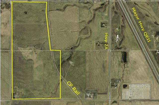 Great development opportunity. 279 acres bordering town of Crossfield. Access to CP rail. Services close by.