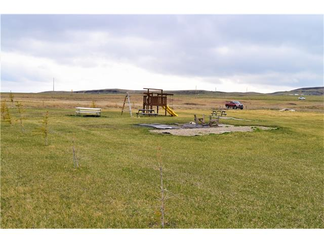 "This great lot awaits your future home designs.......located in the Pine Coulee Ranch Estates Phase II at the north end of Pine Coulee Reservoir and only an hour south of Calgary!! Approach into the lot has been installed along with a gravel pad. The pad is on a higher portion of the lot and offers a nice picnic area. Power and natural gas close by. Included is an 8' x 8"" storage shed and a children's play centre. This lot is situated only 5 minutes from the boat launch which is at the south end of the Pine Coulee Reservoir....boating, fishing, waterskiing. No building commitment and minimal arch. controls. With beautiful views of the hills to the west and prairie landscape to the east, you will want to invest now for your future!!"