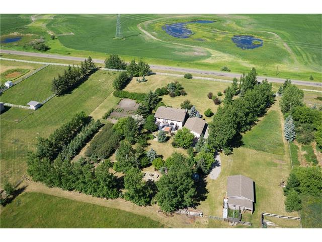 BEAUTIFUL home w/over 2454 sq ft of developed living space on 5.86 acres w/TRIPLE OVER-SIZED + HEATED GARAGE, PRESSURIZED WATER SYSTEM off barn, WORKSHOP, GREENHOUSE, CHICKEN COOP + FIRE PIT w/STUNNING MOUNTAIN VIEWS! TONS of features + UPDATES you will LOVE inc ALL NEW WINDOWS, NEW ROOF on house + barn, NEW H2O tank, NEW washer + dryer, NEW CAESAR STONE COUNTERS, UPDATED BATHROOMS, NEW appliances, NEW DECK, SKYLIGHT, CUSTOM BUILT-INS, HIGH END BLINDS + more! Steps lead up to the main level w/living rm, GORGEOUS kitchen w/OAK cabinetry, CAESAR STONE counters, NEW STAINLESS STEEL appliances + BIG breakfast bar overlooking the dining area w/doors leading to the LARGE 2-tier DECK + HOT TUB! a family bathroom + 3 GOOD SIZED bedrooms on the main level inc the Master Suite w/3 piece EN-SUITE bathroom w/WALK-IN shower! The WALK-UP basement has a BIG FAMILY rm w/NEW FIREPLACE + WET BAR area, 3 piece bathroom + 2 additional BEDROOMS! TONS of storage rm + MUD RM leads to WALK-UP stairs to access the BEAUTIFUL YARD!