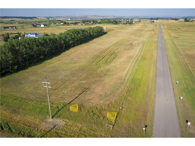 3.14 ACRES of ABSOLUTELY STUNNING land in the ROLLING COUNTRYSIDE of the FOOTHILLS w/SUPER QUICK + EASY ACCESS to Highway 2, Okotoks + Calgary! BUILD YOUR DREAM HOME here w/BEAUTIFUL MOUNTAIN VIEWS, CONVENIENT ***PAVED*** ACCESS, FLAT SITE, DRILLED WATER WELL, POWER, NATURAL GAS, all on SITE + ready in place! Located on a QUIET CUL-DE-SAC in a small sub-division on a LARGE PRIVATE LOT, this land is GREAT VALUE + available for a QUICK POSSESSION to get your build underway! VIEWS ALL AROUND of the GORGEOUS land w/WILDLIFE GALORE! GRAB this FANTASTIC opportunity w/BOTH HANDS! TAKE a short DRIVE OUT, YOU WON'T BE DISAPPOINTED! This is REALLY GREAT VALUE for the $$$ when you consider the POTENTIAL + GREAT LOCATION of this LAND! Easy to please Restrictive Covenants are not extreme so there is lots of flexibility on building your AMAZING Dream Home in this QUIET location. These value priced LOTS are SURE to IMPRESS even the most DISCRIMINATING of BUYERS. Call TODAY for all available details!!!