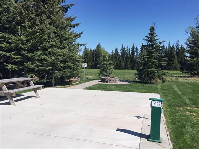 "PRICE REDUCED! All the work is done! One of the best lots in Coyote Creek Golf & RV Resort Phase 3 backing onto the 7th hole of the golf course. Fully serviced with water, power & sewer connection. The 21' x 60' concrete pad is in and the lot is beautifully landscaped with a fire pit and stone work at the rear of the property. A custom shed is ready to store your toys and supplies. This peaceful and well maintained community is the perfect place to relax in nature with all the amenities that you need to be comfortable. Just minutes West of Sundre, and 45 minutes from Calgary on paved roads, this ""Stay and Play"" vacation community has an 18 hole golf course, licensed clubhouse, Wi-Fi Service, laundry & shower facilities, horse shoe pits and play ground. The lot size is 3867 square feet with a reasonable condo fee of only $100/month which includes water, sewer and common area maintenance. Come and take a look at this beautiful lot! You won't ever want to leave."