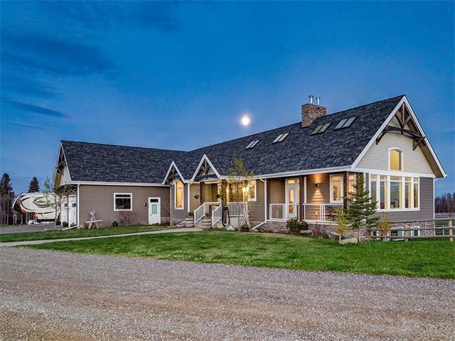 Mountains and VIEWS for days!! 9.68 ACRES!!!!  2009-Built Home: STUNNING WALKOUT Bungalow w/over 4800sf dev. HAND-PLANED, WIDE-PLANK, dark MAPLE HARDWOOD, Gorgeous TOWERING double-sided ROCK Fireplaces up & down. 21' ceilings!!!! Loads of windows, to take in all jaw dropping views. Kitchen is incredible with HUGE GRANITE island, HIGH-END appliances, 6' SXS STAINLESS Fridge/Freezer, 6-burner gas range, & 2 ovens. $48,000 heating system, GENEROUSLY-sized Bedrooms. STEAM shower in 5PC Ensuite, oversized DEN, Beautiful bar, Living/games room and don't forget the media room. HORSE SET UP: 3-stall (hi spec) 30x48 Lofted BARN w/N&S Doors, RV Parking & Tack Room plus Round Ring, Full size barrel racing area. Paddocks/Pastures w/Solid large-pole Fencing, Waterers & Shelters. This is an incredible spot taking in the land, the location, and last but not least, THE VIEWS.