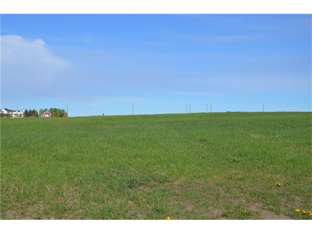 **GREAT PRICE** for this 2.9 acre parcel 15 minutes SouthWest of Calgary. CHOOSE YOUR BUILDER and build your dream home. Services~~GAS and POWER are to the property line as well as a PAVED ROAD AND ACCESS. LOTS OF WATER as the drilled well is 8 GPM.  NO BUILDING COMMITMENT. Some restrictions are in place. The prices does include GST. Five minutes to Okotoks and all your shopping. Close to GOLF courses. Very Easy commute.  PASTORAL views.