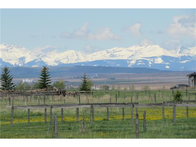 If you are looking for a fantastic mountain view to build your dream home this 5.04 acres is it. Located only minutes away from Okotoks and High River. Property is Perimeter fenced and cross fenced, the drilled well has never been used and it produces 8 gal/minute. Located only 8 Kilometers North East of High River. Great access to High Way 2 you are only 1.5 KM to the High Way. The property is located on a quiet road with very little traffic there is no through road. Take a short drive and see for yourself. You will not be disappointed.