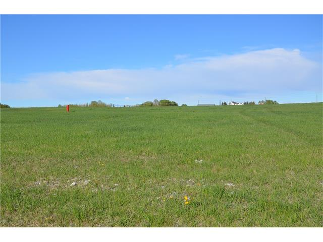 **WONDERFUL 2.96 PARCEL OF LAND ideal to build your DREAM home. MINUTES TO OKOTOKS AND CALGARY. All paved roads lead to the property and features sweeping PASTORAL VIEWS. Natural gas and power are at the property line. The drilled well is 8 GPM. Golf courses and shopping are close by.  Take a drive out and walk around the property or choose one of the other lots that are available.