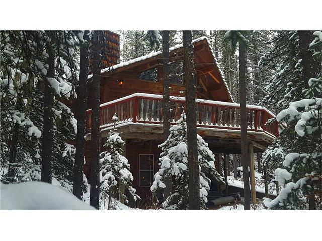 Always wanted to own a little piece of paradise?  Located on the Lower Kananaskis Lake, Whispering Pines was originally a small A-frame with a stunning Linwood Homes addition built on in time for the 1988 Olympics.  The result is a spacious cabin with spectacular views, nestled among the pines and just steps away from the Lake.   Fully furnished and complete with all household goods, you can just unlock the door and begin enjoying this spectacular mountain retreat.  There are two bedrooms on the main floor as well as a great loft that sleeps 5.  The wood burning fireplace has circulating fans to keep you cozy on the coldest of winter nights, and the large deck is a spectacular place for your morning coffee.  Also included is a 14? fishing boat with motor to help you win the annual Fishing Derby, a canoe, paddle boat and bar-b-que.  Make this your mountain home and enjoy all the recreational opportunities Kananaskis has to offer right out your front door!