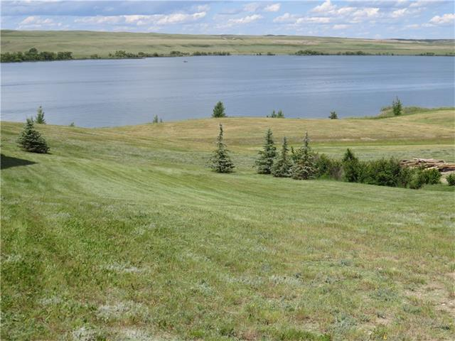 Looking to built that Lake Dream home well here is the perfect Lake Front lot. With stunning views and just 1.5 hours from Calgary. This fabulous lake resort is located on Traver's Reservoir one of the warmest spots in Alberta. This deep, beautiful, & clean lake meets the requirements for a great recreational get away. In the summer enjoy, boating (Little Bow Resort has its own private marina); swimming with a sandy beach. Little Bow Resort is also great as a year-round recreation destination with ice fishing & skating in the winter. This lot is located in Vista Heights with fantastic lake views and above a natural beach. There will be no construction between the lot and the water as this area is protected. All Little Bow lots are fully serviced with high speed internet available. Wouldn?t it be great to stroll onto your deck in the morning with your coffee and take in the quiet and beauty of the lake or take the kids to the beach for an afternoon swim? Call today to start bringing you dream to a realty!