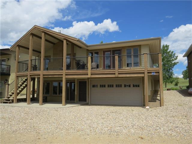 You must see this custom designed & built home with all the room you need for a large family to enjoy. This large 2 Story home has over 1566 sq./ft. of living space on the main floor with three bdrs, a full baths & ensuite in the master, The large open concept Kitchen, Living Rm, & Dining Rm area features lots of windows, Vaulted wood ceilings and stone fire place. The custom-built wood stairs lead down to two additional bedrooms & family Rm., The double attached garage can fit your boat & additional toys. There is a large wrap around deck to enjoy dinner in the evening & coffee in the morning and this home is a short walk to the beach. Can you imagine driving 1.5 hrs from Calgary to a fabulous lake resort? Little Bow Resort is located on Traver's Reservoir one of the warmest spots in Alberta where cactus grows wild. This deep, beautiful, & clean lake has all the requirements for a great recreational get away & it's not overcrowded. Little Bow is a great year-round recreation destination.  Call Today!