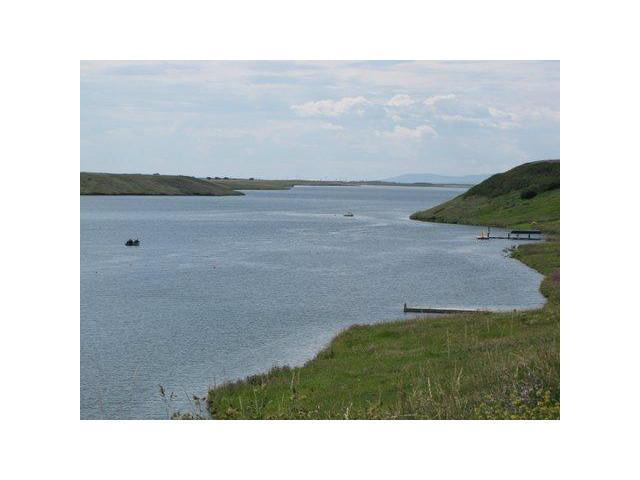 Near a 9 mile reservoir for lake activities.  Water skiing, boating, fishing and more.  R1 lots permitted to build with the MD of Willowcreek, in Claresholm.  Build your dream home when you wish and with your choice of builder.  the lots are in a condominium  project for the residents to have control of the interior road.  Fees projected to be $100 a YEAR (annually). A resident Board of Directors will be elected following a few more lot sales.  This condominium project is made this way only to handle the road requirements, building architectural guidelines with a restrictive covenant administrated by the Owner now and will turn over to the Board once elected.  All building is by permits issued by the MD of Willowcreek.  Each lot is applicable to GST.  Just a short walk to the water, and a Provincial boat launch south of the lots.  Provincial Camping area also to the south near the boat launch.  Future water for home will be holding tank (water delivered) & for septic. Services are along road Power/gas.
