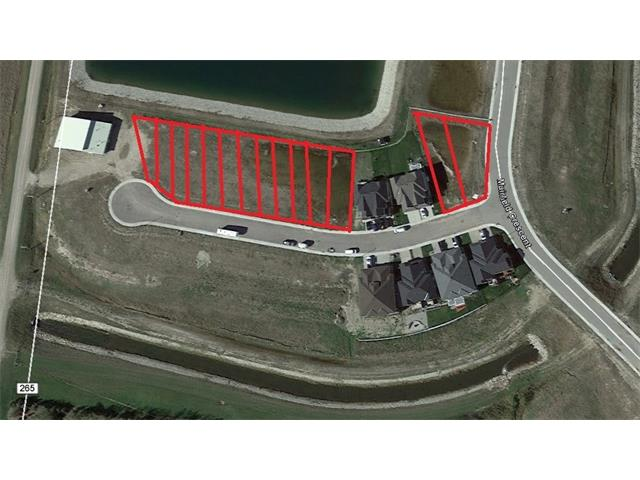 Beautiful Corner semi-detached Villa lot situated on a quiet cul-de-sac.  Enjoy the incredible views and the quiet lifestyle in this gated golf course community. Lakes of Muirfield is close to Calgary, Chestermere and Strathmore. There are several lot options available.