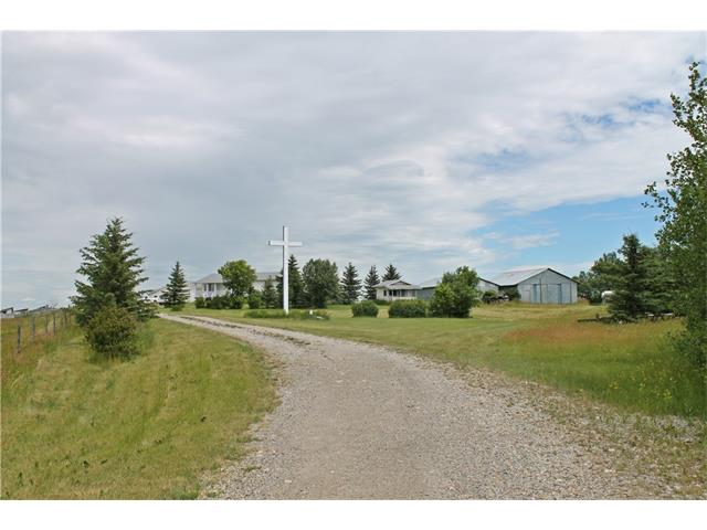 Investors take note! 156 Acres ON CITY LIMITS!  Views of downtown and the mountains. Next to the Shepard Industrial Area Structure Plan. Currently zoned agricultural, land is adjacent to several acreages with industrial zoning. Property has a great walkout bungalow (developed basement with kitchen, two bathrooms and 2 bedrooms) large double attached garage, RV parking, and very large garden. Lots of out buildings including two large machine sheds, play house, and cattle shelter. Owner may consider some low interest financing. Must be seen, call Realtor today! Gst may be applicable.