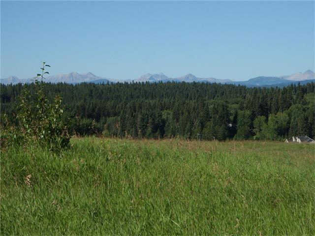 $20,000. PRICE REDUCTION! MARQUIS RANCHES! This 125 acre community offers EXCEPTIONAL, PANORAMIC Rocky Mountain and Foothills views. LOT 4, at 9.85 acres, is by far the BEST VALUE in the subdivision! Build your DREAM HOME! Bring the horses and 'live the dream'! Or hold this beautiful property as a solid investment. You'll love the paved access road, community water co-op and architectural guidelines which secure views and building standards to protect your investment. No building commitments. All utilities available at the property line. Located in the rolling Foothills 10 min West of Calgary and 5 km NW of the hamlet of PRIDDIS, You are next door to the world-class Priddis Greens Golf Club. All the recreational amenities of Kananaskis Country-a 4,257 sq km mixed-use recreation paradise-are 10 minutes to the West. What an exceptional location to call 'Home Sweet Home'! Enjoy the beautiful photos and call today to experience this outstanding development and property first-hand. See you soon!