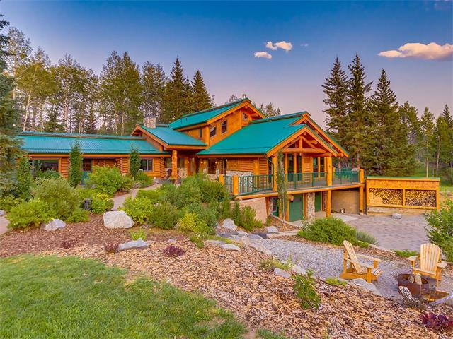 Welcome to this incredible property nestled in the beautiful mountain setting just minutes to Bragg Creek. An incredible Log framed home which is more what you would find at a ski lodge rather than get to call your very own. At 6000 feet of developed space you will see why we don't call it a log cabin. This home is gorgeous from the moment you turn into the property. Over 9 acres of privacy with a creek, mountain views and set back into the trees its hard to find such a combo. Another perk of this property is the Saddle and Sirloin community pasture for riding horses on the 80 acres. Step into this home and the log details will leave you in awe. So beautiful to see a log home done to this level, and real treat just to be in it. The kitchen is gorgeous and the mainfloor is ideal for hosting parties or maybe just having the family gather for holidays. Standing in the mainfloor its hard to not just stare out the large windows at the mountain views and take in the beauty of this setting.