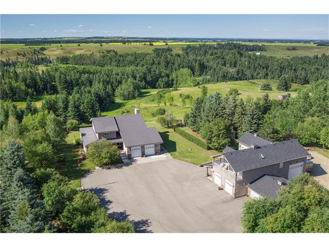SPECTACULAR ONE of KIND property on 68.2 ACRES w/2 RESIDENCES w/over 5983 sq ft of DEVELOPED living space, 3445 sq ft of GARAGE SPACE w/RV PARKING + WORKSHOPS, 1603 sq ft ENGINEERED wrap around 2013 DECK, STUNNING MOUNTAIN VIEWS, KM's of QUAD TRAILS, FARM INCOME + just a quick drive from Innisfail! Main house 2 storey WALK-OUT w/MANY UPDATES inc NEWER windows, HIGH END SECURITY system, RENOVATED EN-SUITE + more! BIG foyer w/GRAND CURVED staircase, living rm, dining rm + BEAUTIFUL kitchen w/GRANITE counters + matching white appliances! Bfast nook to the HUGE deck + family rm w/BRICK FIREPLACE! Large laundry rm, mud rm w/WALK-IN closet + half bath. Upstairs is a family bathroom + 4 GOOD SIZED bedrooms inc the Master Suite w/GORGEOUS NEW EN-SUITE w/GLASS SHOWER + SOAKER TUB! The FINISHED basement has a BIG rec rm, bathroom w/STEAM SHOWER + media rm! The 2nd 2014 BUILT residence above the MASSIVE garage space has 2 bedrooms, OPEN CONCEPT living/dining area + GORGEOUS kitchen! Being sold w/21.42 acre listing!