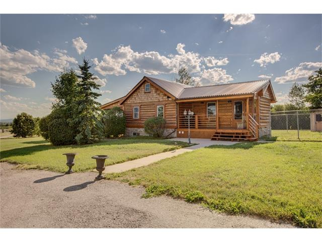 Here is an HISTORIC opportunity to own an HISTORIC acreage in the heart of South Springbank. This outstanding property right off Springbank Road offers over 18+ acres and is what History is all about. The refurbished 1887 log home with 3 bedrooms surrounded by classic farm equipment is the perfect place to live while you build your dream home you have always wanted up against the trees at the back of the acreage. Enjoy your morning coffee looking at the outstanding views of the Alberta Foothills and the Rocky Mountains. And when your finished building you can use the Log Home as your guest house or office. There is a large Quonset 70? X40? that has been set up for Automobile work or can store all your farm equipment. The single car garage can also be used as an office or art studio. This property has a great opportunity to have an Impressive Equestrian Set-up with Level ground & Fenced Horse Pasture with Waterer and this property can also be subdivided. Call today for a private showing!