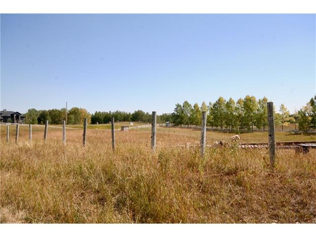 Private with gorgeous sky views, rolling 3.68 acre parcel tucked away off Poplar Hill Drive in Bearspaw, just 1.2 km east of the new Silverhorn subdivision. No Building commitment &  NO RESTRICTIVE COVENANT. Perfect for a horse set up. All services to property line including water co-op. Quick access to shopping, Bearspaw School, Community Centre & airport. Nearest cities are Calgary and Cochrane. Adjacent lot may be purchased to total 8 acres +/-. If both lots are purchased at the same time. A reduction of $20,000.00 of the listing price is offered on the second  lots closes before November 1, 2017.GST applicable and for more questions contact listing agent. Take Crowchild WEST to Bearspaw Road, turn NORTH, go approx 5.6 km, just past Jewel Valley to Township Road 262, turn WEST, take next turn NORTH on Poplar Hill Dr. Lots on WEST side.