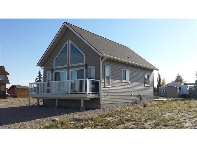 Cottage located at Lake McGregor Country Estates, a four season RV and Cottage resort located about 90 minutes southeast of the City of Calgary. Built in 2009, this cottage is a 1 and 1/2 story two bedroom one bathroom place that is waiting for you! Basement is framed for a bathroom, two bedrooms, rec room and laundry room. Low maintenance landscaping with a large concrete pad and fire pit. The loft is currently used as a family room. Large windows in the living room and dining area let the sun shine in! Lake McGregor Country Estates features a fully serviced clubhouse with indoor and outdoor pools, hot tub, sauna, exercise and games rooms, family and adult lounges, as well as a large auditorium. There are also outdoor basketball, tennis and beach volleyball courts. The resort has it's own private beach, marina and boat storage areas. The lake is popular with fishermen and boating enthusiasts. The community association fees are $1800 per year.