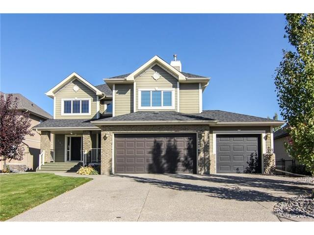 """**  OPEN HOUSE **  SUNDAY, DECEMBER 17th  **  2:30PM - 4:30PM  **  Please click on """"Multimedia"""" for 3D tour!  Welcome to an amazing, fully developed 2 storey home on a huge lot in exclusive """"The Lake at Heritage Pointe""""!  Fantastic features include:  3+1 bedrooms, over 3753 total developed square feet, walkout basement with fabulous wet bar, massive wrap around deck, huge patio (gas lines up AND down), exposed aggregate sidewalks/patio/driveway, large chef's kitchen with gas range & massive granite island, steam shower, underground sprinklers, in-slab/in-floor heat, insulated oversized triple garage with 220V & much more!  Location is a 10/10 - SO close to 5 world class golf courses, 10 min drive to excellent public (K-9) & catholic school (K-8 - soon to be K-9), short walk to the lake entrance and easy access to Deerfoot Trail & MacLeod Trail!  The Lake at Heritage Pointe is a HOA community - no condo fees.  This amazing home is move-in ready and has all the bells & whistles - just move right in!"""