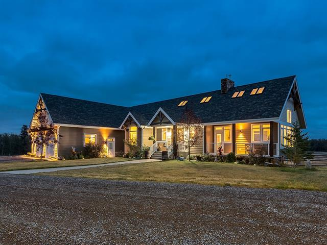 BEAUTIFUL CUSTOM WALK-OUT bungalow w/over 5061 sq ft on 9.86 STUNNING acres w/INCREDIBLE MOUNTAIN VIEWS + TRIPLE ATTACHED HEATED garage! PERFECT HORSE SET UP w/30x48 HEATED DRIVE-THRU BARN w/3 stalls, tack rm + LOFT, SHELTERS, WATERERS + ROUND PEN! MANY features you will LOVE inc VAULTED CEILINGS, WIDE PLANK HARDWOOD + SLATE floors, UPGRADED APPLIANCES, FULL A/C, $48,000 heat system inc IN-FLOOR heat, FULL LENGTH DURA DECK + more! The SPACIOUS main floor has a LARGE foyer, OPEN CONCEPT living + dining rm w/SOARING STONE DOUBLE SIDED FIREPLACE! GORGEOUS kitchen w/GAS STOVE, DUAL WALL OVENS, INDUSTRIAL FRIDGE + BEAUTIFUL GRANITE ISLAND! Huge WALK-THRU PANTRY, half bath, OFFICE, LAUNDRY rm w/SINK + MUD rm! The MASTER SUITE has a HUGE WALK-IN closet + 5 pce EN-SUITE w/DUAL GRANITE VANITY, SOAKER TUB + STEAM SHOWER! FANTASTIC basement has HUGE REC RM area w/D-SIDED FIREPLACE, PROJECTOR system + GREAT WET BAR, HALF BATH, 2 FURTHER GOOD SIZED bedrooms + 5 pce bathroom! WALK-OUT to the HUGE PATIO area w/FIREPIT!