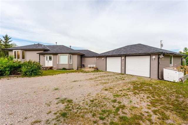 Location, Location, Location!!! This Beautiful 1637sq ft Home is so close to Chestermere and Calgary with the Peace & Quiet to Enjoy Acreage Living! Get Ready to Bring All the Animals and Toys? with 6.7 Acres there is Plenty of Room to Roam and No More RV Storage! The Boat Launch is just 3 1/2 km away as well !! This Well Kept Home Features a HUGE Kitchen with Newer Appliances and Tons of Cupboard Space that the Chef of the House is sure to Love. Freshly Painted with Brand New Carpet on the 3rd level and a Total of 4 Bedrooms & 4 Baths. Outside you will find an OVERSIZED Double Detached Garage with a Greenhouse on the rear, Garden Shed, Apple Trees, Saskatoon & Raspberries Bushes. So close yet so far away ?. The convenience to order Pizza Delivery right to your Door, Schools, Shopping & Entertainment all close by! Just 3 minutes from Chestermere with Fantastic Neighbours and Community Lifestyle. Quick Possession is Possible, Get ready to Enjoy all the Seasons in your Beautiful New Private Oasis!!!