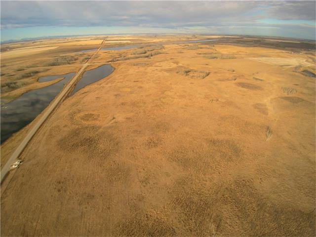 Great location on pavement. 151.83 acres of pasture, some could be cultivated. Possibility of gravel deposits. $4,000 annual lease payment. Call for more details