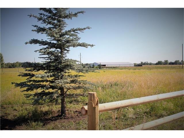 This beautiful parcel of land is only minutes south west of High River. The wonderful neighborhood and location captures and promotes  a spectacular building site to call home. This 2.42 acre parcel has wonderful mountain views and is surrounded by many estate homes. All utilities are serviced to the property line and the roads are all paved to the property. This is a great opportunity to embrace rural living with the convenience of town amenities so close. The well has been tested and has a recommended pumping rate of three GPM. There are Restrictive Covenants in place to enrich your dream home. For additional information - please call.