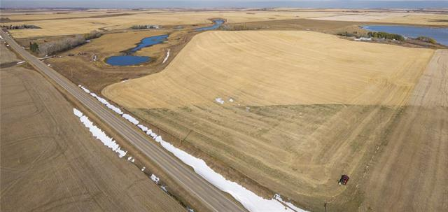 ***MOTIVATED SELLER! OFFERS WELCOME***60.44 ACRES ½ a mile off Highway 1 & siding on Highway 561 + only 3 minutes to the NEW k-12 WHEATLAND CROSSING SCHOOL! AMAZING INVESTMENT & DEVELOPMENT POTENTIAL w/50 PERMANENT WATER RIGHTS on the WESTERN IRRIGATION DISTRICT CANAL + income from FARM LAND that produced over 100 bushels per acre barley! Looking for a special piece of property with UNLIMITED water & great income potential, you have found it. Looking to INVEST, hold on & reap the benefits later, build your DREAM HOUSE, or need a great piece of land for Residential or COMMERCIAL development that requires water, this is it!! Zoned AG which can allow AG Operations, Nursery, Greenhouse, Bed and Breakfast, Modular home, Kennel, home business, Equestrian Centre, day home & more! VIEWS of a protected Ducks Unlimited pond, the FOOTHILLS & MOUNTAINS & only 10 minutes from Strathmore and 35 minutes from Calgary. Services to property line including 3 PHASE POWER. Can be sold with adjoining 16 acre & 16 acre pieces
