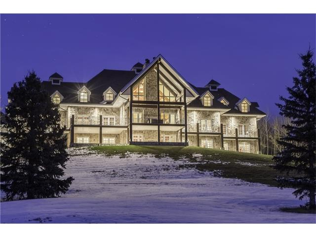 A once-in-a-lifetime opportunity to create your own legacy on one of Alberta?s most significant estates. Pelican Lodge offers an unparalleled private residence on approximately 150 picturesque, lakefront acres. This one of a kind property includes approx 1.2 kilometres of lakefront living on serene Gadsby Lake, a private 9-hole, par 35 lakeside golf course, 5 pristine ponds, approx 3.25 kilometres of paved pathways and mature trees in an otherwise cleared surrounding area.  The over 10,000 sq.ft. residence is an exquisite showplace for grand-scale entertaining, adorned with mosaic German Solnhofen Limestone flooring, artisanal metalwork, fir interior doors, trim and feature Glulam wood beams, and cherry cabinetry. The spectacular view of Gadsby Lake can be enjoyed from most rooms including the grand living space anchored by a two-story cultured stone woodburning fireplace. Meticulously designed this manor home remains partially undeveloped awaiting finishing touches by the next fortunate owner.