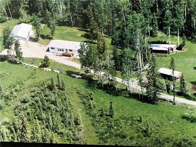 WESTERN WILDERNESS AND WILDLIFE are bountiful in this 140.63 acres 15 min west of Sundre!  Beautiful rolling land in Alberta's foothills features a mix of forest and meadows! Spacious and extremely well cared for 1800 sq. ft. 1999 Modular with 3 bedrooms, 2 full baths, a formal living room and a separate family room.  The large open kitchen and dining area features an open plan, counter space galore and lots of oak cupboards!  Outside there is a 32x52 shop, heated and insulated, a tin sided cold storage the could easily convert to a barn and a larger tack/storage shed.  The land is currently rented to a long term tenant for cattle and the bonus of oil/gas lease income of $4100/yr!  So come, where the deer and the wildlife roam!  Call today to view!